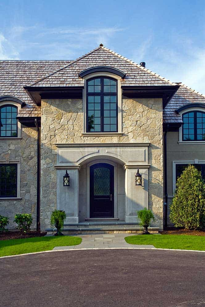 Large Arched Front Entry Windows Reflect the French Provincial Design