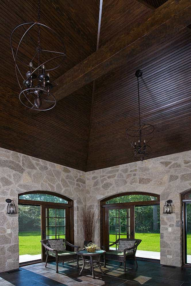 Breathtaking Dark Wood Paneled Ceiling with Wrought Iron Chandeliers