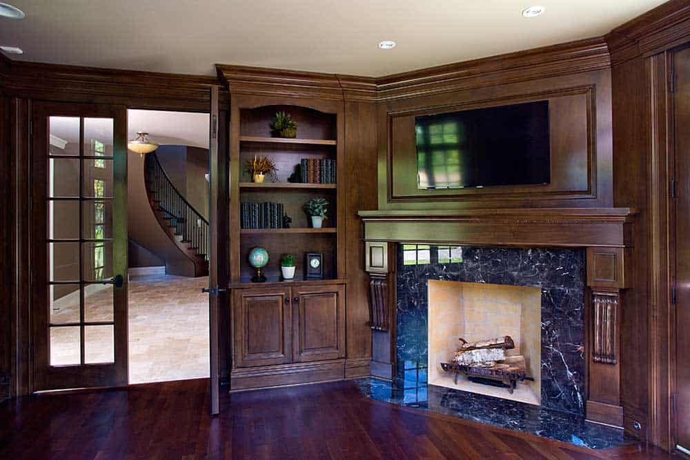 Study includes a Wood Burning Fireplace & Built-In Shelving