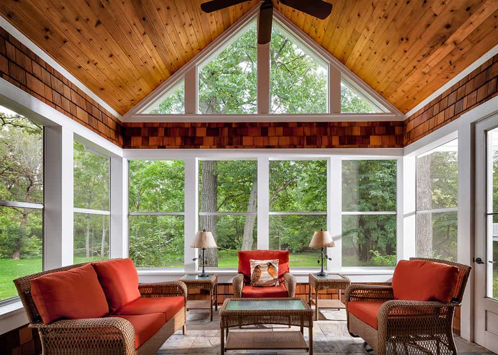 sunroom with knotty pine ceiling and cedar shake detailing