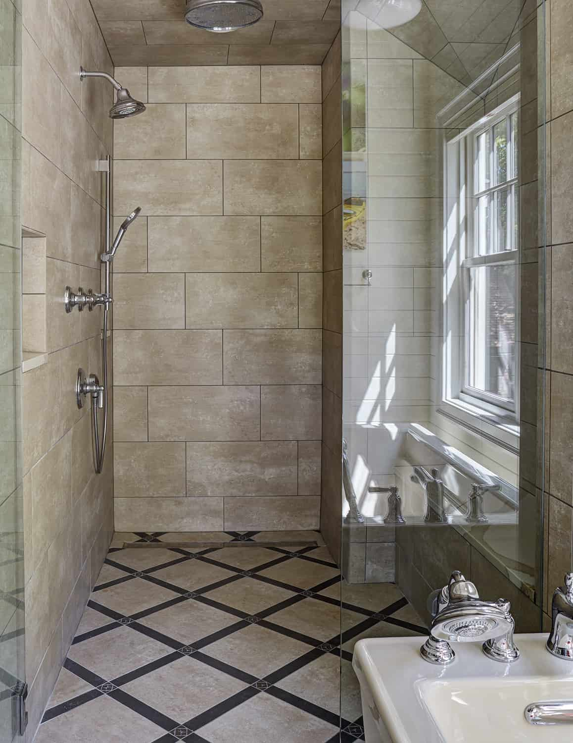 master shower with stone flooring