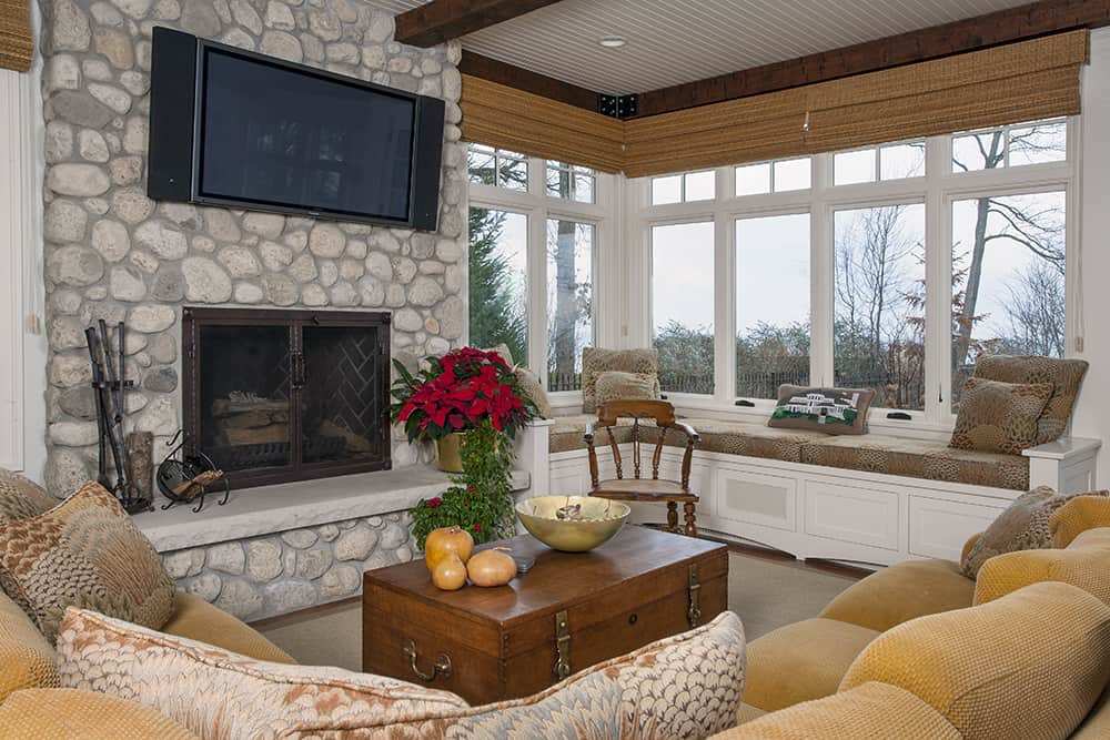 sitting room with stone fireplace and view to lake michigan